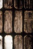 Oud gebrandschilderd glasvenster in het stof Royalty-vrije Stock Afbeeldingen