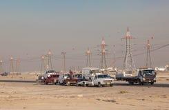 Oud GMC die vrachtwagens in Koeweit slopen Stock Afbeeldingen