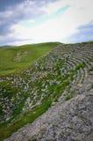 Oud Grieks in een godvergeten gat Verloren Amfitheater Royalty-vrije Stock Fotografie