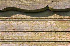 Oud groen geschilderd hout stock foto's