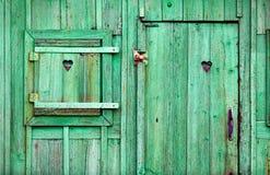 Oud groen houten deuren en venster Stock Afbeelding