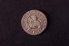 Oud Groot Hertogdom van het muntstuk van Litouwen helft-grosz-half op de donkere achtergrond stock fotografie
