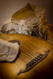 Oud Guitar Lute and white rustic baroque shirt Royalty Free Stock Photos