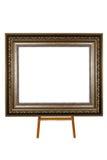 Oud houten die fotokader op schildersezel op wit wordt geïsoleerd royalty-vrije stock foto's