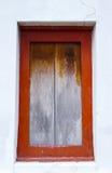 Oud houten venster op muur Stock Foto