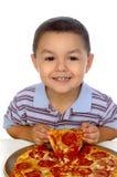 Oud jong geitje en pizza 3 jaar Stock Afbeeldingen