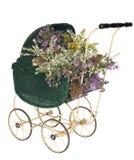Oud-manierstuk speelgoed kinderwagen met wildflowers Royalty-vrije Stock Foto's