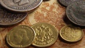 Oud muntstukpapiergeld stock footage
