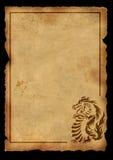 Oud perkament met het beeld van een draak royalty-vrije illustratie