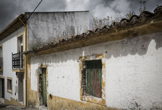 Een oud huis naast een modern gebouw stock photos 26 images