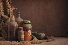 Oud stoffig flessenstilleven Stock Fotografie