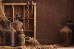 Oud stoffig flessenstilleven Stock Afbeelding