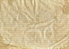 Oud uitstekend bruin verfrommeld document in een heerser met plonsen en vlekken royalty-vrije stock fotografie