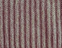 Oud verdwijn rode of roze wol gebreide textuur abstracte achtergrond langzaam Stock Foto's
