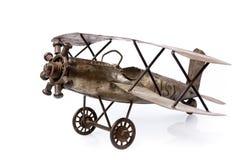 Oud vliegtuigstuk speelgoed op wit Stock Fotografie