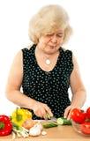 Oud vrouwen kokend voedsel royalty-vrije stock foto