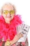 Oud vrouwen winnend geld Stock Afbeeldingen