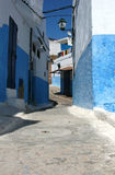 Oudaia Kasbah. A narrow street with houses lime-washed in blue or white in the Oudaia Kasbah in Rabat, Morocco. The Oudaua Kasbah is the oldest part of the Royalty Free Stock Photography
