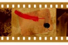 Oude 35mm frame foto met uitstekende pagina en veer Royalty-vrije Stock Foto's
