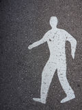 Oude asfalttextuur met wit mensenteken Royalty-vrije Stock Foto
