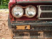 Oude autokoplampen stock afbeelding