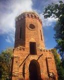 Oude baksteen gebouwde toren Stock Afbeelding
