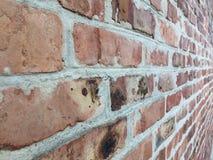 Oude bakstenen muur in een achtergrond Stock Foto