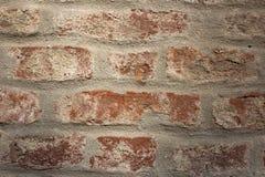 Oude bakstenen muur in een achtergrond Stock Afbeelding