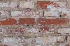 Oude bakstenen muur met overblijfselen van pleister Royalty-vrije Stock Afbeelding