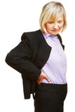 Oude bedrijfsvrouw die rugpijn hebben Royalty-vrije Stock Afbeeldingen