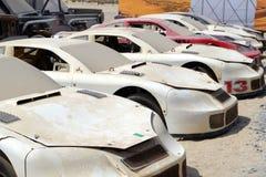 Oude beschadigde sportwagens stock foto