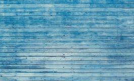 Oude blauwe sjofele houten planken met gebarsten kleurenverf Royalty-vrije Stock Foto's
