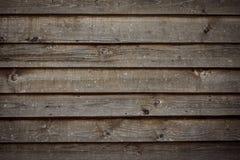 Oude bruine houten raad, textuurachtergrond, chocoladekleur Stock Foto's