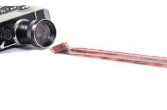 Oude camera en film geïsoleerde strook Stock Afbeelding
