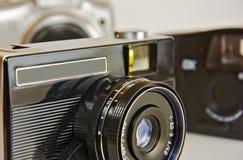 Oude camera om op filmclose-up te vangen Stock Foto's