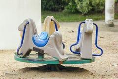 Oude carrousel in de speelplaats royalty-vrije stock foto