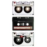 Oude cassette drie die op wit wordt geïsoleerdu Stock Foto