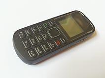 Oude cellphone met knopen stock afbeelding