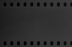 Oude celluloidfilm met stof en krassen stock foto's