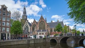 The Oude Church in Amsterdam city, Netherlands time lapse.  stock video footage
