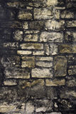 Oude dark grunged bakstenen muur Royalty-vrije Stock Foto's