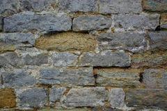 Oude de textuurachtergrond van de steenmuur stock fotografie