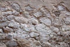 Oude dichte omhooggaand van de steenmuur backgraund Royalty-vrije Stock Afbeeldingen