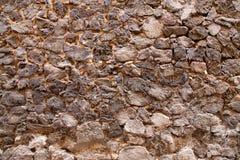 Oude dichte omhooggaand van de steenmuur backgraund Royalty-vrije Stock Foto