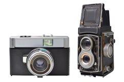 Oude die camera's op witte achtergrond worden geïsoleerd Stock Afbeeldingen