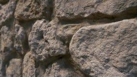 Oude die muur van grote stenen wordt gemaakt stock video