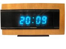 Oude digitale uren per het houten geval. Stock Foto