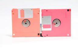 Oude diskette gezet op witte achtergrond Stock Fotografie