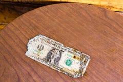 Oude dollarrekening op een lijst Stock Foto
