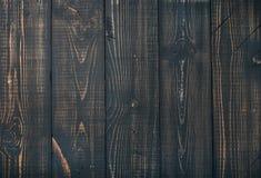 Oude donkere geschroeide houten textuur, behang of achtergrond Stock Afbeeldingen